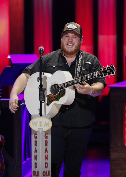 """Luke Combs performs at """"Luke Combs Joins the Grand Ole Opry Family,"""" at Grand Ole Opry, Tuesday, July 16, 2019, in Nashville, Tenn. (Photo by Al Wagner/Invision/AP)"""