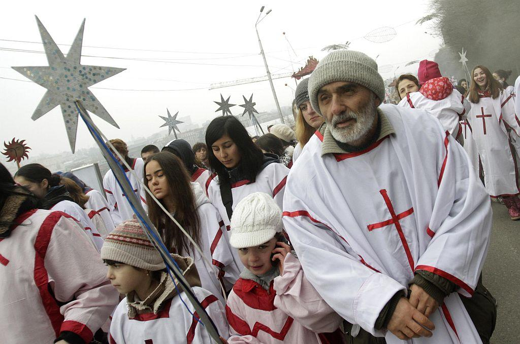 """GEORGIA: Participants march on the street during """"Alilo"""", a religious procession, to celebrate the Orthodox Christmas in Tbilisi January 7, 2013. Believers celebrate Christmas on January 7, according to the Julian calendar used by the country's Orthodox church."""