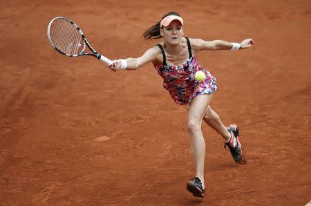 Agnieszka Radwanska of Poland competes in her women's singles match against Ajla Tomljanovic of Croatia at the French Open tennis tournament at the Roland Garros stadium in Paris