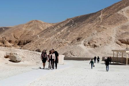 FILE PHOTO: Tourists walk near the newly renovated tomb of boy pharaoh King Tutankhamun in Valley of the Kings in Luxor