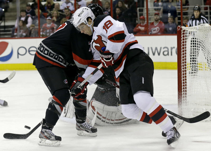 Carolina Hurricanes' Ryan Murphy, left, defends against New Jersey Devils' Steve Bernier (18) during the first period of an NHL hockey game in Raleigh, N.C., Friday, Nov. 29, 2013. (AP Photo/Gerry Broome)