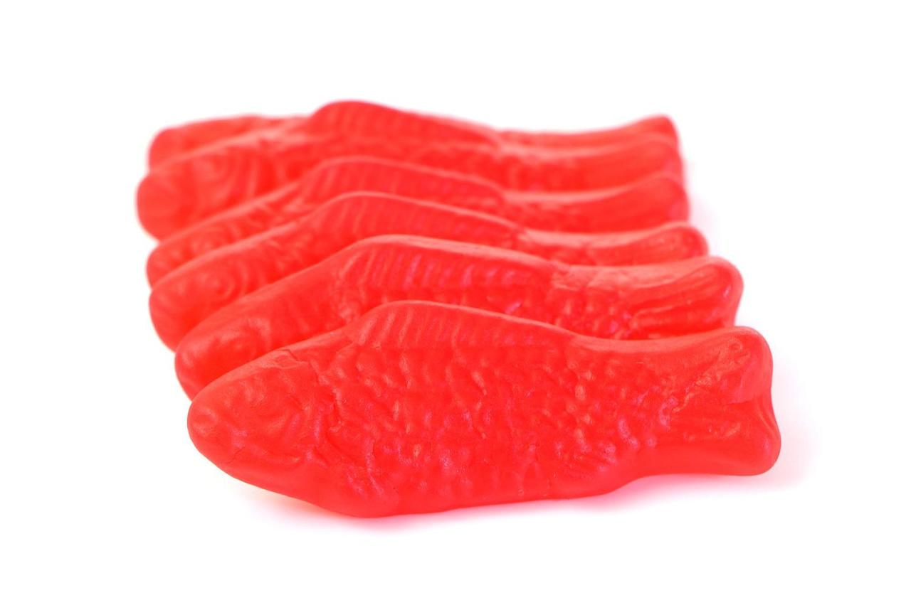 <p>Thankfully, these Swedish Fish candy canes from Spangler Candy don't actually taste like fish. They, of course, get their name from the bright red gummy candy. These stripeless candy canes are a pure, bright red, ensuring they will stand out when hung on your Christmas tree.</p>