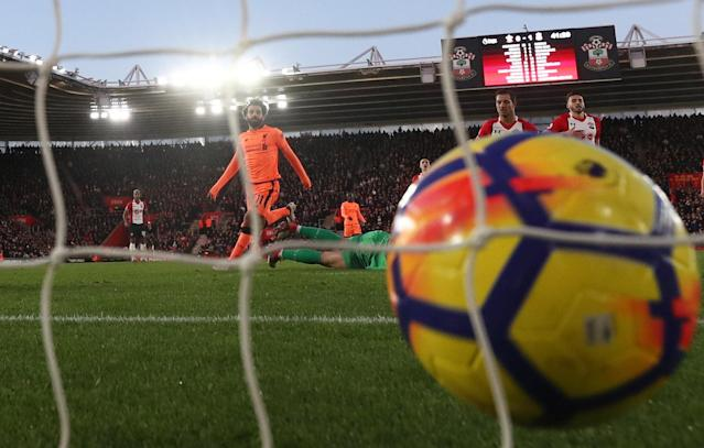 "Soccer Football - Premier League - Southampton vs Liverpool - St Mary's Stadium, Southampton, Britain - February 11, 2018 Liverpool's Mohamed Salah scores their second goal REUTERS/Eddie Keogh EDITORIAL USE ONLY. No use with unauthorized audio, video, data, fixture lists, club/league logos or ""live"" services. Online in-match use limited to 75 images, no video emulation. No use in betting, games or single club/league/player publications. Please contact your account representative for further details."