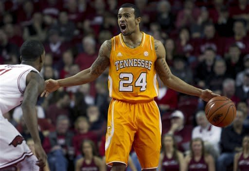 Tennessee's Brandon Lopez (24) yells a play to his team during the first half an NCAA college basketball game in Fayetteville, Ark., Saturday, Feb. 2, 2013. (AP Photo/Gareth Patterson)