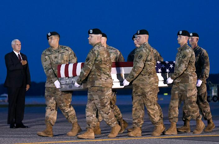 Vice President Mike Pence, left, watches an Army carry team move a transfer case containing the remains of Sgt. Eric M. Houck at Dover Air Force Base, Del., June 12, 2017. (Photo: Steve Ruark/AP)