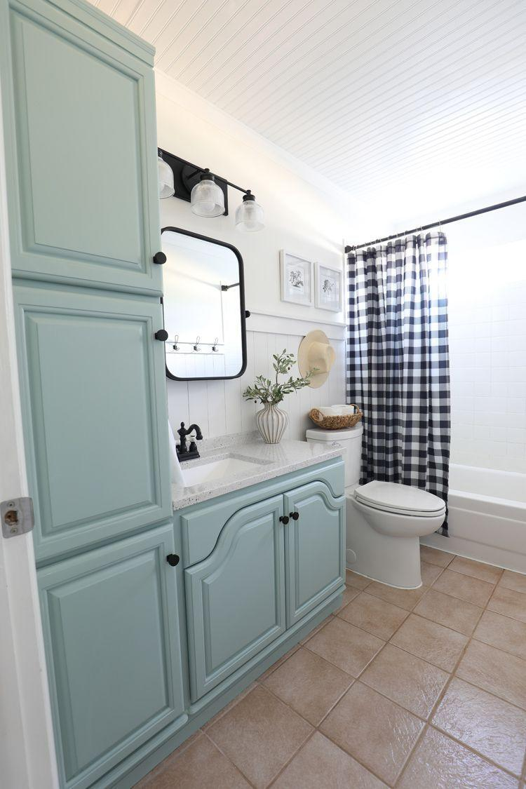 """<p>Revamping your dated basement bathroom can be as simple as adding new lighting, a new mirror—and lots of paint. A gingham print shower curtain and your favorite straw hat brings a little dose of country chic style. </p><p><strong>See more at <a href=""""https://www.thecraftpatchblog.com/downstairs-bathroom-remodel-sponsored/"""" rel=""""nofollow noopener"""" target=""""_blank"""" data-ylk=""""slk:The Craft Patch"""" class=""""link rapid-noclick-resp"""">The Craft Patch</a>. </strong></p><p><a class=""""link rapid-noclick-resp"""" href=""""https://go.redirectingat.com?id=74968X1596630&url=https%3A%2F%2Fwww.walmart.com%2Fip%2FMoDRN-36-Inch-Beveled-Wall-Mirror-with-Shelf-Black%2F700213192&sref=https%3A%2F%2Fwww.redbookmag.com%2Fhome%2Fg36061437%2Fbasement-ideas%2F"""" rel=""""nofollow noopener"""" target=""""_blank"""" data-ylk=""""slk:SHOP MIRRORS"""">SHOP MIRRORS</a></p>"""