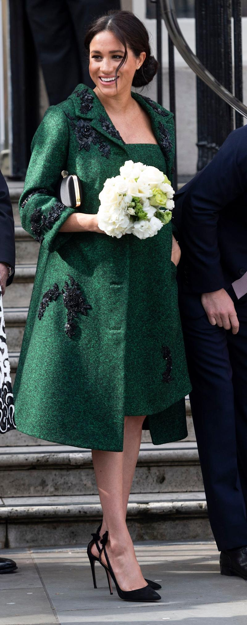 Nothing to see here, just a regular, super casual emerald coat and matching dress from — where else? — one of her favourite labels, Erdem, founded by a Canadian.