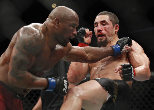 Robert Whittaker, right, and Yoel Romero fight during their middleweight title bout at the UFC 225 mixed martial arts event early Sunday, June 10, 2018, in Chicago. (AP Photo/Jim Young)