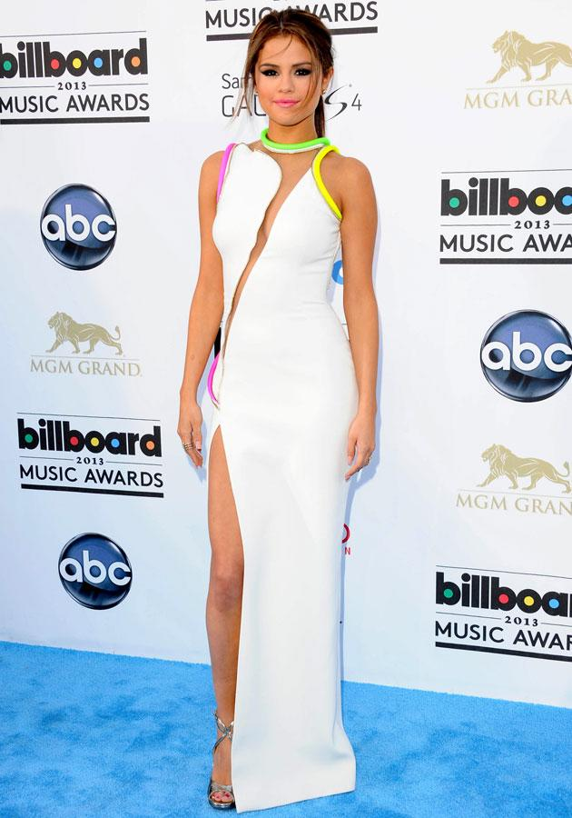 Best dressed: Selena Gomez wowed in a white Atelier Versace SS13 frock with neon accents.