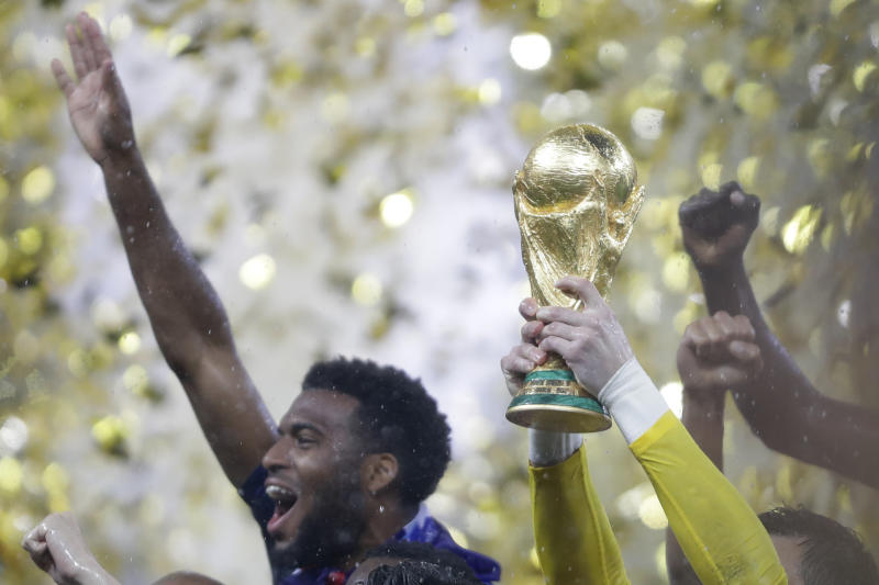 France goalkeeper Hugo Lloris holds the trophy after winning the final match against Croatia at the 2018 soccer World Cup in Moscow, Russia, Sunday, July 15, 2018. (AP Photo/Natacha Pisarenko)