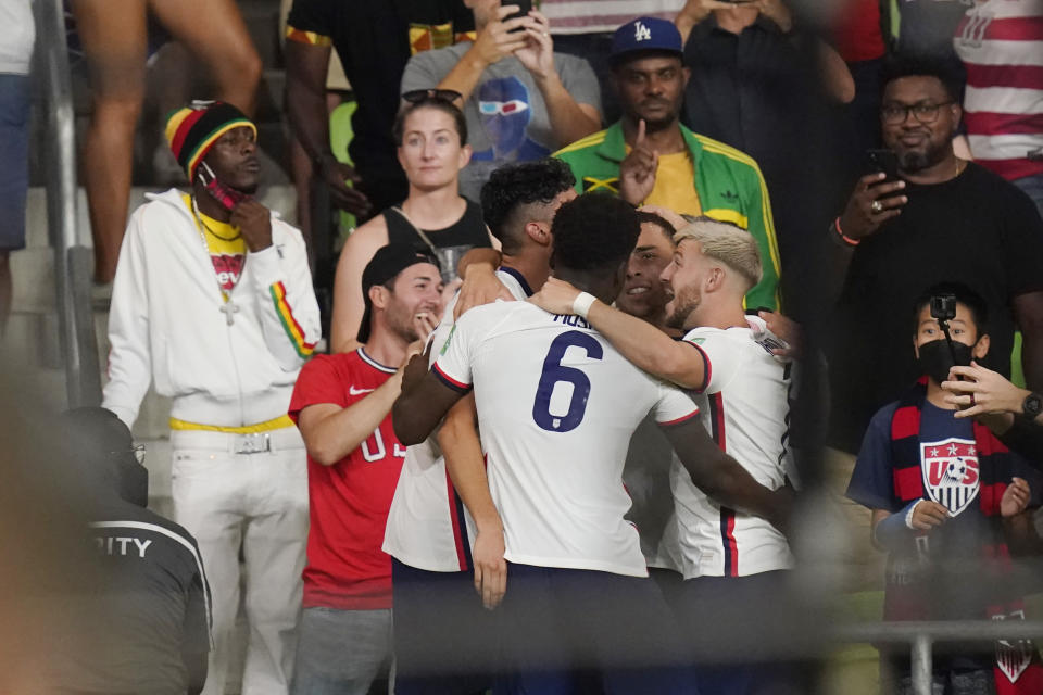 United States' Yunus Musah (6) celebrates with teammates after the team scored against Jamaica during a FIFA World Cup qualifying soccer match Thursday, Oct. 7, 2021, in Austin, Texas. (AP Photo/Eric Gay)