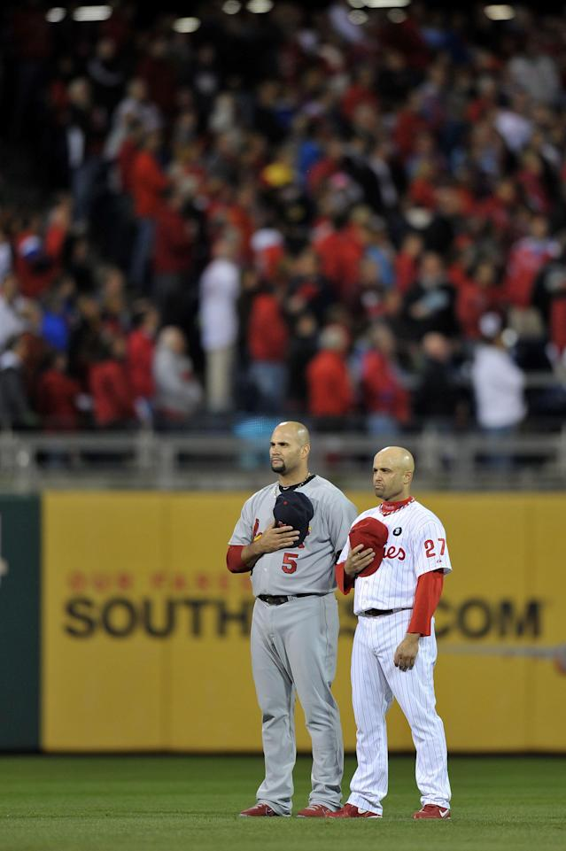 PHILADELPHIA, PA - OCTOBER 02: Albert Pujols #5 of the St. Louis Cardinals and Placido Polanco #27 of the Philadelphia Phillies stand during the national anthem prior to Game Two of the National League Division Series at Citizens Bank Park on October 2, 2011 in Philadelphia, Pennsylvania. (Photo by Drew Hallowell/Getty Images)