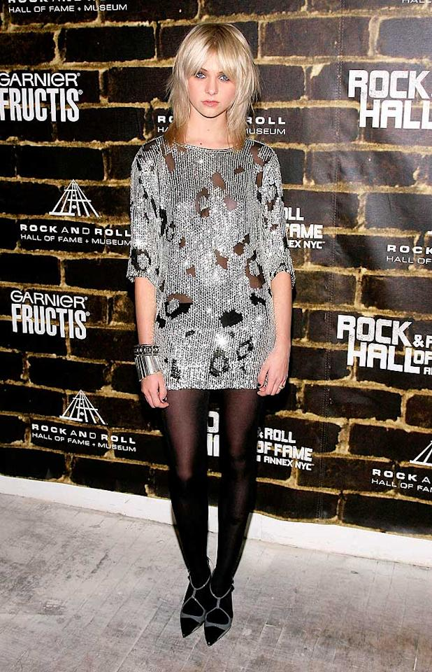 """December 2008: Although it was chilly in NYC, a sullen Taylor rebelled by donning a silver, see-through dress. It's safe to say that this was the beginning of her anti-fashion statements.   <a href=""""http://www.seventeen.com/fashion/makeovers/ashley-tisdale-fashion-makeover-pics?link=rel&dom=yah_omg&src=syn&con=art&mag=svn"""" target=""""new"""">Ashley Tisdale's Style Transformation</a> Joe Kohen/<a href=""""http://www.wireimage.com"""" target=""""new"""">WireImage.com</a> - December 2, 2008"""