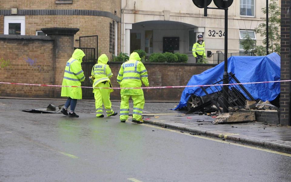 Police deal with the aftermath of the crash in Notting Hill which killed three people - UK News in Pictures