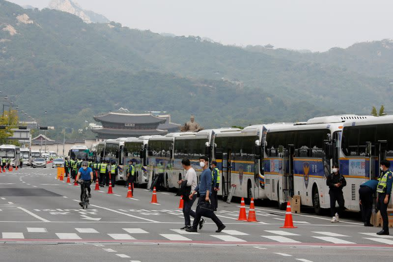 South Korea police set up 'bus walls' to prevent protests amid COVID-19 concerns