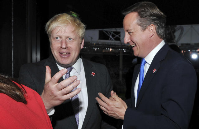 Britain's Prime Minister David Cameron, right, and Mayor of London Boris Johnson chat prior to the Opening Ceremony of the 2012 Olympic Summer Games at the Olympic Stadium, London, Friday, July 27, 2012. (AP Photo/John Stillwell, pool)