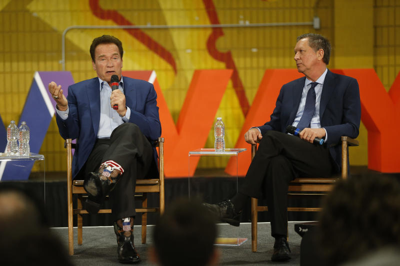 Former California Gov. Arnold Schwarzenegger, left, and Ohio Gov. John Kasich, participate in the first New Way California Summit, a political committee eager to reshape the state GOP, at the Hollenbeck Youth Center in Los Angeles Wednesday, March 21, 2018. (AP Photo/Damian Dovarganes)