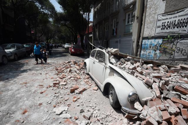 <p>Picture of a car crashed by debris from a damaged building after a quake rattled Mexico City on September 19, 2017.<br> A powerful earthquake shook Mexico City on Tuesday, causing panic among the megalopolis' 20 million inhabitants on the 32nd anniversary of a devastating 1985 quake. The US Geological Survey put the quake's magnitude at 7.1 while Mexico's Seismological Institute said it measured 6.8 on its scale. The institute said the quake's epicenter was seven kilometers west of Chiautla de Tapia, in the neighboring state of Puebla.<br> (Photo: Alfredo Estrella/AFP/Getty Images) </p>