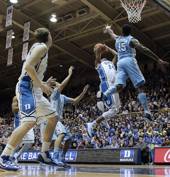 Duke's Rasheed Sulaimon (14) drives to the basket as North Carolina's P.J. Hairston (15) defends during the first half of an NCAA college basketball game in Durham, N.C., Wednesday, Feb. 13, 2013. (AP Photo/Gerry Broome)