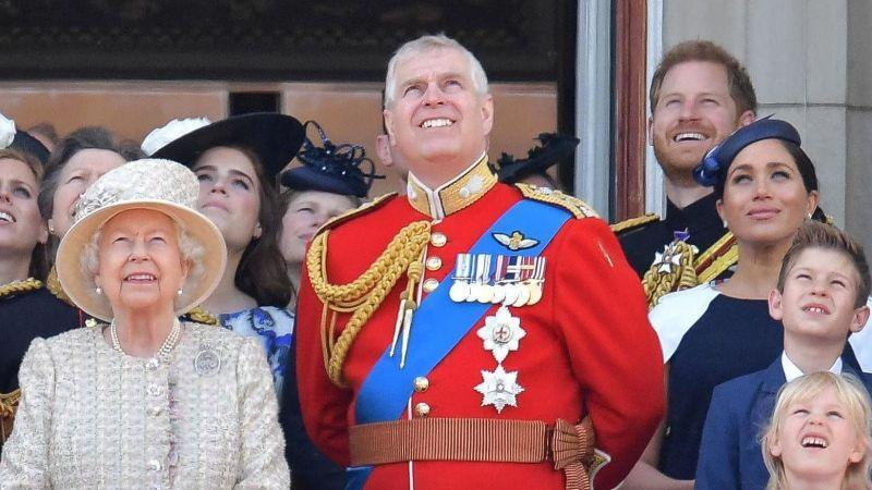 (L-R) Britain's Queen Elizabeth II, Britain's Princess Eugenie of York, Britain's Prince Andrew, Duke of York, Britain's Prince Harry, Duke of Sussex, and Britain's Meghan, Duchess of Sussex, stand with other members of the Royal Family on the balcony of Buckingham Palace  on June 8, 2019.