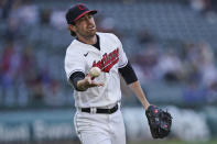 Cleveland Indians starting pitcher Shane Bieber tosses the ball to first base to get Chicago Cubs' Joc Pederson out in the third inning of a baseball game, Tuesday, May 11, 2021, in Cleveland. (AP Photo/Tony Dejak)