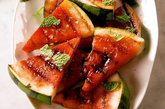 """<p>Add some smokiness to watermelon by grilling it for just 2 minutes. You'll get hooked.</p><p><em><strong>Get the recipe from <a href=""""https://www.delish.com/cooking/recipe-ideas/a27184567/grilled-watermelon-recipe/"""" rel=""""nofollow noopener"""" target=""""_blank"""" data-ylk=""""slk:Delish"""" class=""""link rapid-noclick-resp"""">Delish</a>.</strong></em></p>"""