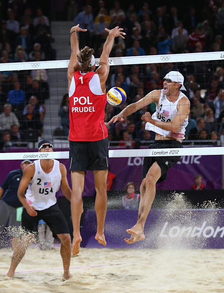 LONDON, ENGLAND - JULY 30:  Mariusz Prudel of Poland blocks against Jacob Gibb of the United States  during the Men's Beach Volleyball Preliminary match between United States and Poland on Day 3 of the London 2012 Olympic Games at Horse Guards Parade on July 30, 2012 in London, England.  (Photo by Ryan Pierse/Getty Images)