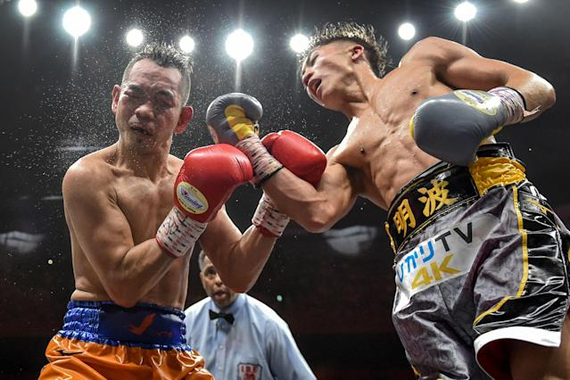 Naoya Inoue (R) and Nonito Donaire fight in their World Boxing Super Series bantamweight final Thursday. Inoue signed with Top Rank after winning a unanimous decision. (Getty Images)