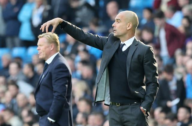 Manchester City manager Pep Guardiola appears to tickle the head of Everton boss Ronald Koeman during a 1-1 draw at the Etihad Stadium in October 2016. Koeman was sacked by the Toffees a year later, while Guardiola recovered from a trophy-less first season in England by winning successive Premier League titles, two Carabao Cups and an FA Cup (Martin Rickett/PA)