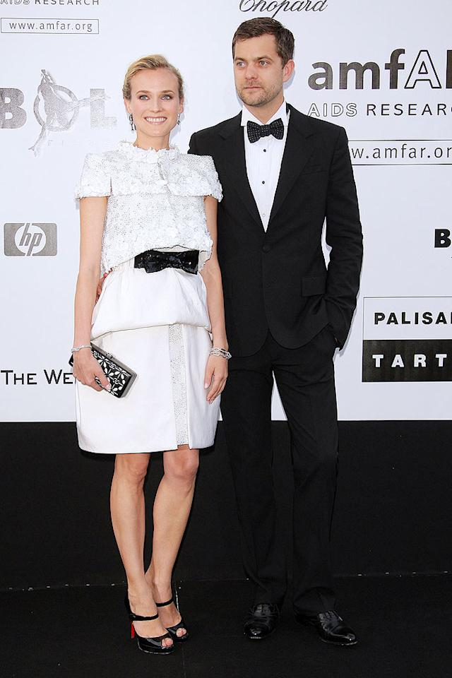 "Diane Kruger donned a white Chanel ensemble, while boyfriend Joshua Jackson was dapper in a tux. Black bows unified their look. Daniele Venturelli/<a href=""http://www.wireimage.com"" target=""new"">WireImage.com</a> - May 21, 2009"