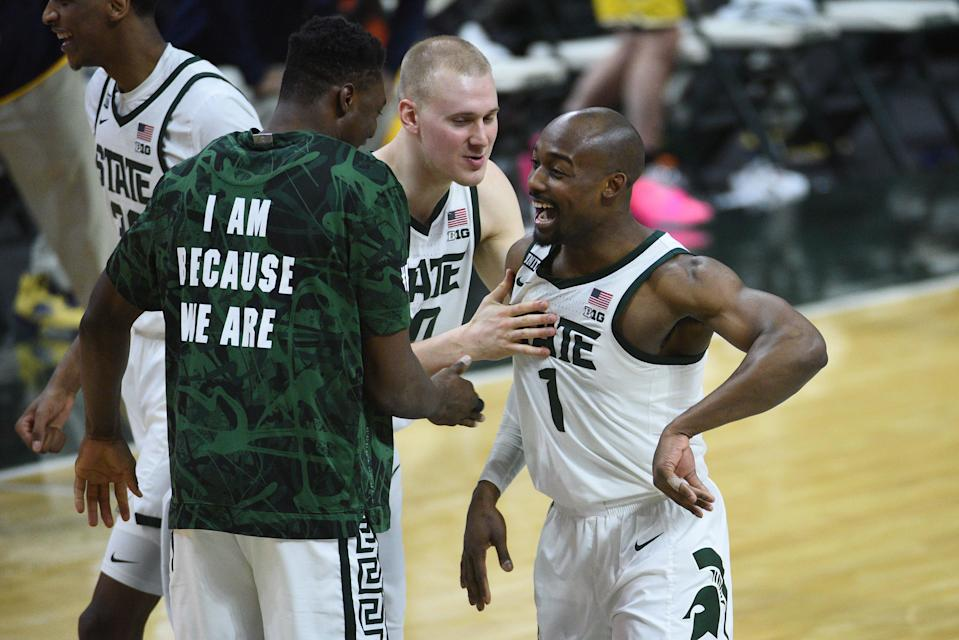 Michigan State guard Joshua Langford (1) celebrates with center Mady Sissoko (22) and forward Joey Hauser (20) after defeating Michigan.