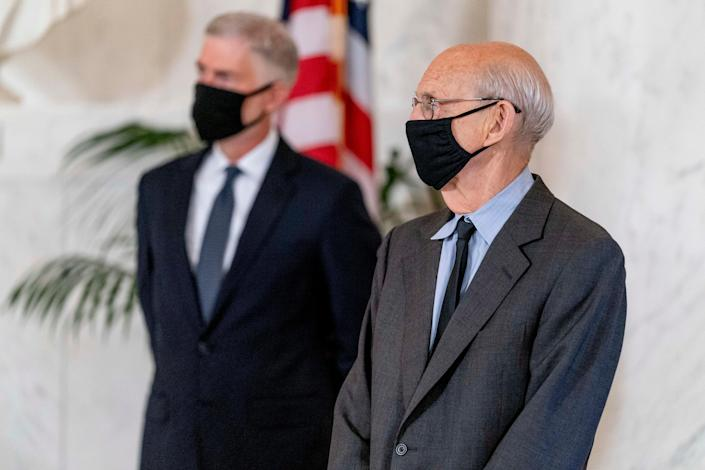 Justice Neil Gorsuch, left, and Justice Stephen Breyer, right, stand during a private ceremony for Justice Ruth Bader Ginsburg at the Supreme Court in Washington, Sept. 23, 2020.