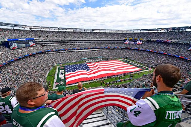 <p>Fans hold an American flag during the National Anthem prior to the game between the New York Jets and the Cincinnati Bengals at MetLife Stadium on September 11, 2016 in East Rutherford, New Jersey. (Photo by Steven Ryan/Getty Images) </p>