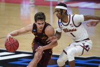 Loyola Chicago guard Braden Norris (4) drives on Illinois guard Trent Frazier (1) during the second half of a men's college basketball game in the second round of the NCAA tournament at Bankers Life Fieldhouse in Indianapolis, Sunday, March 21, 2021. (AP Photo/Paul Sancya)
