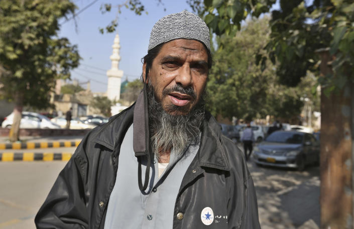 Sheikh Muhammad Aslam, brother of British-born Pakistani Ahmed Omar Saeed Sheikh, who is charged in the 2002 murder of American journalist Daniel Pearl, leaves the Sindh High Court, in Karachi, Pakistan, Thursday, Dec. 24, 2020. The provincial court overturned a Supreme Court Decision that Ahmed Omar Saeed Sheikh should remain in custody during an appeal of his acquittal on charges he murdered Pearl. (AP Photo/Fareed Khan)
