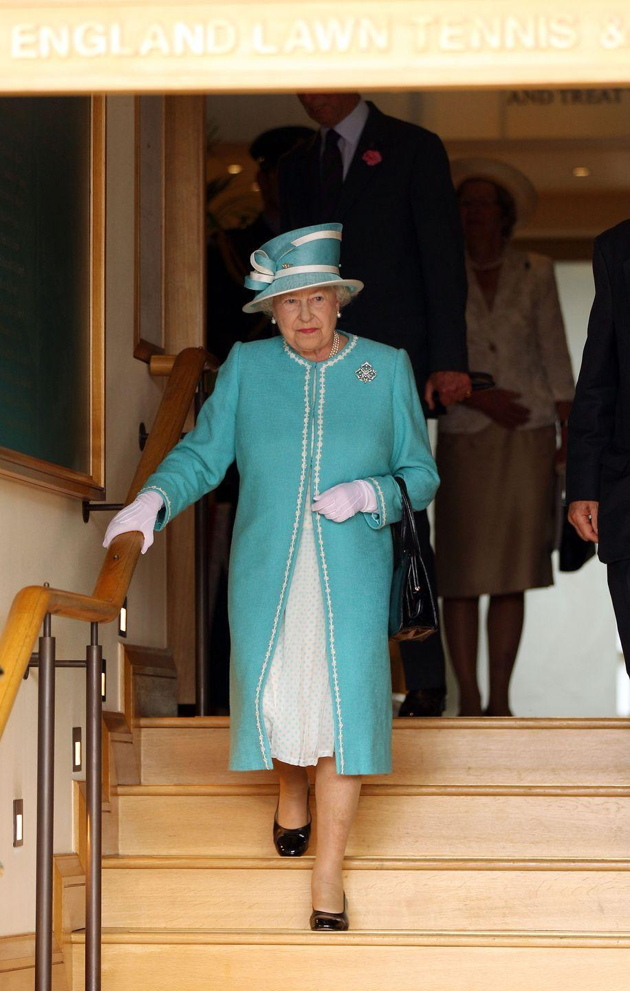 <p><strong>2010</strong> The Queen attended Wimbledon for the first time in over three decades, wearing a bright blue ensemble for the occasion.</p>