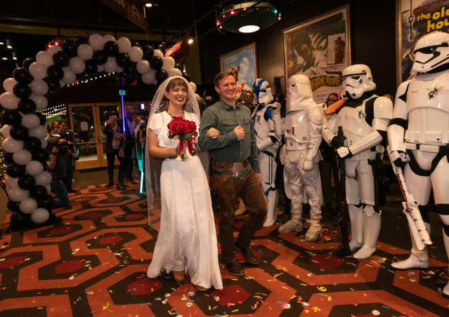 """""""Star Wars' fans Wendee and Andy Forbes marry in the lobby of the Alamo Drafthouse Cinema in Austin, Texas, before the premiere screening of """"The Rise of Skywalker."""" (Photo: Erika Rich)"""