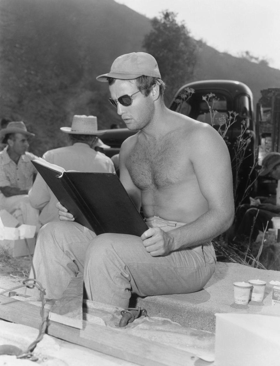 <p>Marlon Brando reviews his script on the set of Julius Caesar, in which he played Marc Anthony. </p>