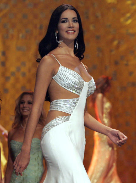 CORRECTS YEAR OF KILLING - FILE - In this May 31, 2005 file photo, Monica Spear, Miss Venezuela 2005, competes at the Miss Universe competition in Bangkok, Thailand. Venezuelan authorities say the soap-opera actress and former Miss Venezuela and her husband were shot and killed resisting a robbery after their car broke down. Prosecutors said in a statement that Monica Spear and Henry Thomas Berry were slain late Monday, Jan. 6, 2014 near Puerto Cabello, Venezuela's main port. (AP Pool/Rungroj Yongrit, Pool)