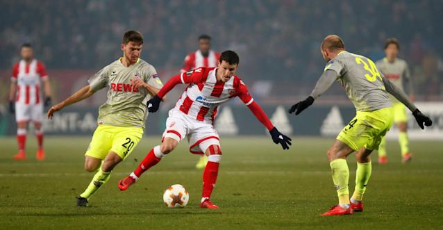 Soccer Football - Europa League - Red Star Belgrade vs FC Cologne - Rajko Mitic Stadium, Belgrade, Serbia - December 7, 2017 Red Star Belgrade's Slavoljub Srnic in action with Cologne's Salih Ozcan and Konstantin Rausch REUTERS/Novak Djurovic