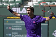 Cameron Norrie, of Britain, reacts after beating Diego Schwartzman, of Argentina, at the BNP Paribas Open tennis tournament Thursday, Oct. 14, 2021, in Indian Wells, Calif. (AP Photo/Mark J. Terrill)