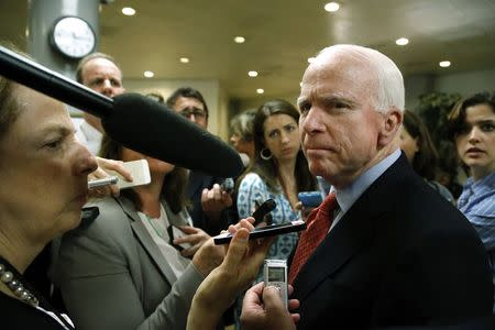 McCain talks to reporters after a closed-door Senate Armed Services Committee briefing on the Bergdahl prisoner swap at the U.S. Capitol in Washington