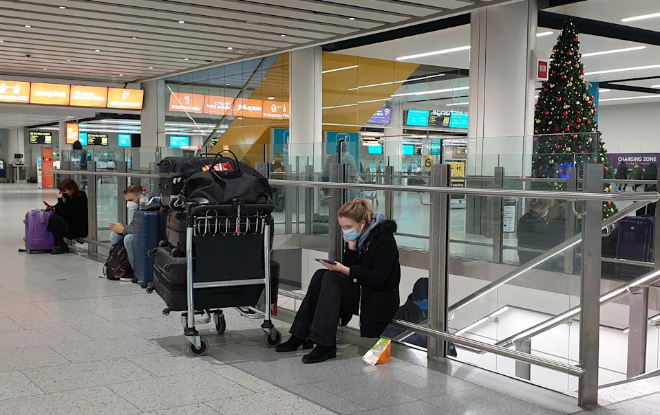 Passengers at Gatwick Airport in West Sussex. (Photo by Gareth Fuller/PA Images via Getty Images)