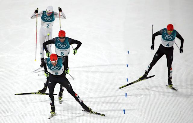 Nordic Combined Events - Pyeongchang 2018 Winter Olympics - Men's Individual 10 km Final - Alpensia Cross-Country Skiing Centre - Pyeongchang, South Korea - February 20, 2018 - Johannes Rydzek of Germany, Fabian Riessle of Germany, Eric Frenzel of Germany and Jarl Magnus Riiber of Norway approach the finish line. REUTERS/Carlos Barria