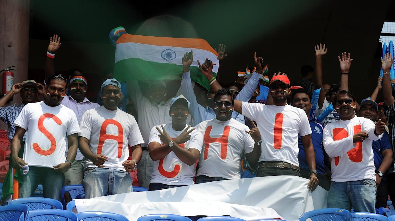 India fans cheers, wearing matching shirts spelling the first name of Indian cricketer Sachin Tendulkar, cheer prior to the Cricket World Cup match between India and England at The M. Chinnaswamy Stadium in Bangalore on February 27, 2011. India and England meet in Bangalore February 27 in a World Cup blockbuster packed with potential heavyweight clashes, but plagued by organisational headaches. AFP PHOTO / Prakash SINGH (Photo credit should read PRAKASH SINGH/AFP/Getty Images)