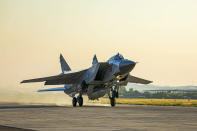 In this photo released by Russian Defense Ministry Press Service on Friday, June 25, 2021, a Russian MiG-31 fighter jet carrying a Kinzhal missile takes off from the Hemeimeem air base in Syria. The Russian military on Friday launched sweeping maneuvers in the Mediterranean Sea featuring warplanes capable of carrying hypersonic missiles, a show of force amid a surge in tensions following an incident with a British destroyer in the Black Sea. (Russian Defense Ministry Press Service via AP)