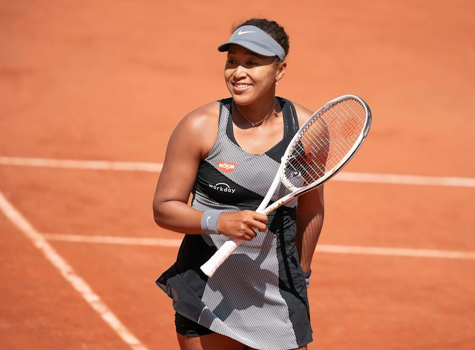 Naomi Osaka, pictured here in the first round of the French Open, will compete at Wimbleton, despite her withdrawal from both Roland-Garros and bett1open in Berlin leading up to the London tournament.