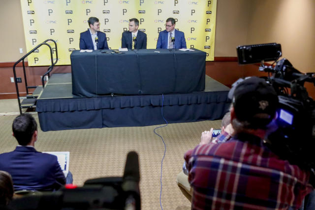 Ben Cherington, center, takes questions beside recently hired team president Travis Williams, right, and team owner Bob Nutting, left, during a news conference where Cherington was introduced as the new general manager of the Pittsburgh Pirates baseball team at a news conference, Monday, Nov. 18, 2019, in Pittsburgh. (AP Photo/Keith Srakocic)