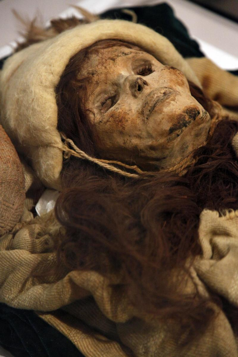 """In a Feb. 18, 2011 photo, the Beauty of Xiaohe, a mummy discovered in the Tarim Basin in far western China, is shown at the """"Secrets of the Silk Road"""" exhibit at the University of Pennsylvania Museum of Archaeology and Anthropology in Philadelphia. The exhibit is scheduled to run through until March 15. Philadelphia is the final stop before the artifacts return to China. (AP Photo/Matt Rourke)"""
