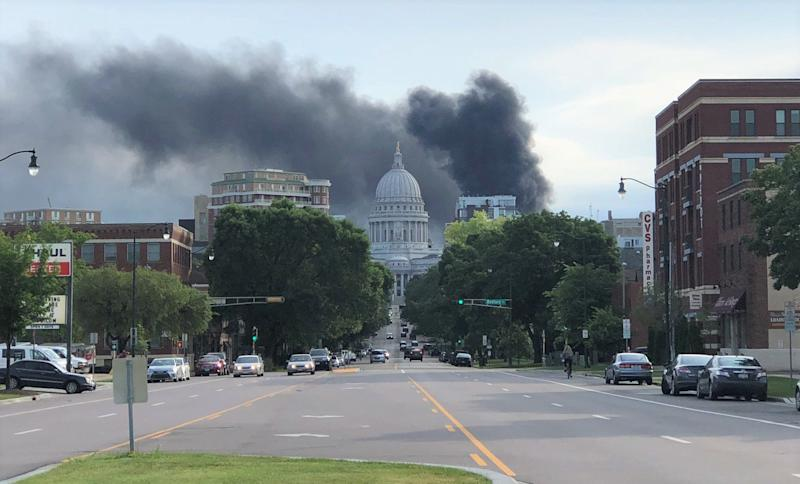Black smoke fills the downtown Madison sky following an explosion and fire at Madison Gas and Electric's main power center and another fire at a substation nearby.